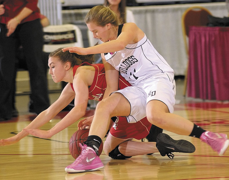 Central junior guard Emylee Miles, left, and Hall-Dale freshman guard Nicole Pelletier slide to the ground as they're about to wrestle for a loose ball during the Class C state championship game on Saturday night at the Augusta Civic Center.