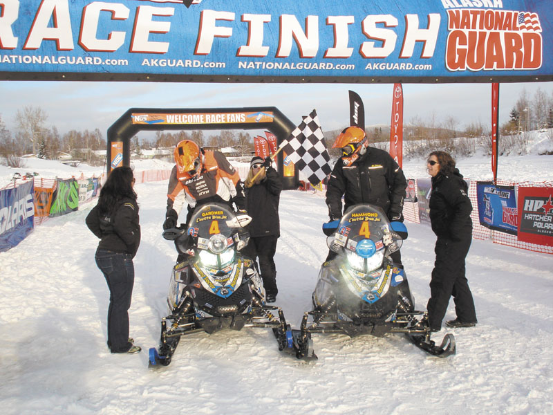 WE DID IT: Rob Gardner, left, and Dave Hammond cross the finish line at the Iron Dog snowmobile race. The duo finished ninth in the race, which is about 2,000 miles long.