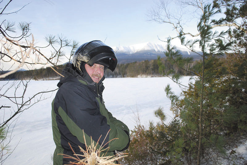 LOOKING IT OVER: Baxter State Park Chief Ranger Ben Woodard says the new regulations regarding solo and small group trips during the winter have proved extremely popular.
