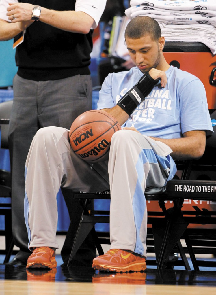 STATUS UKNOWN: North Carolina guard Kendall Marshall sits on the bench during practice Thursday in St. Louis. Marshall broke his right wrist and his status for today's game against Ohio is uncertain.