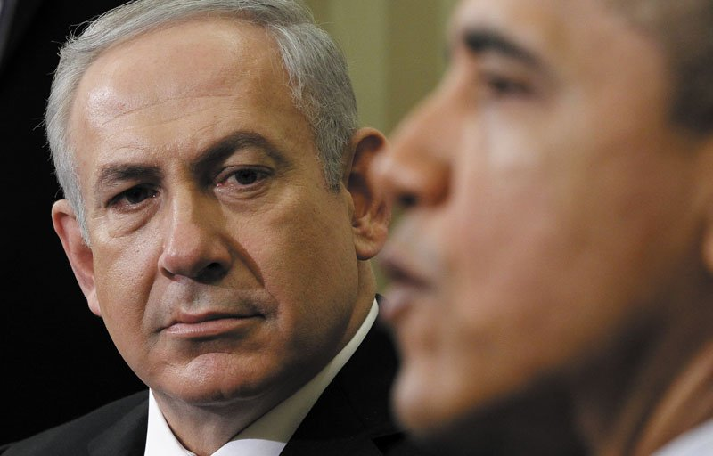 Israeli Prime Minister Benjamin Netanyahu listens Monday as President Barack Obama speaks during their meeting in the Oval Office of the White House in Washington. Among the issues discussed was how to deal with Iran.
