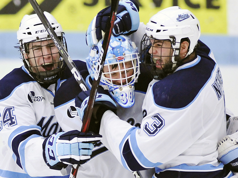 Maine goalie Dan Sullivan, center celebrates with Ryan Hegarty (44) and Mark Nemec (3) after defeating Merrimack in a Hockey East tournament quarterfinal Sunday in Orono.