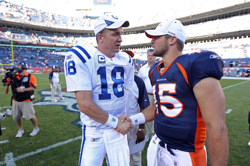 CROSSING PATHS: Former Indianapolis Colts quarterback Peyton Manning, left, greets Denver Broncos quarterback Tim Tebow before a 2010 game in Denver. Manning is negotiating to join the Broncos, ESPN reported on Monday. That decison would put Tebow's future with the team in doubt. NFL