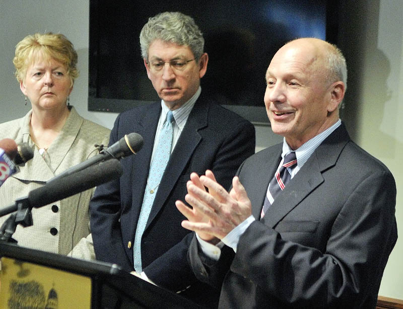 Westbrook Mayor Colleen Hilton, left, and Augusta Mayor William Stokes, listen as Portland Mayor Michael Brennan, right, speaks during a news conference at the State House on Thursday in Augusta.
