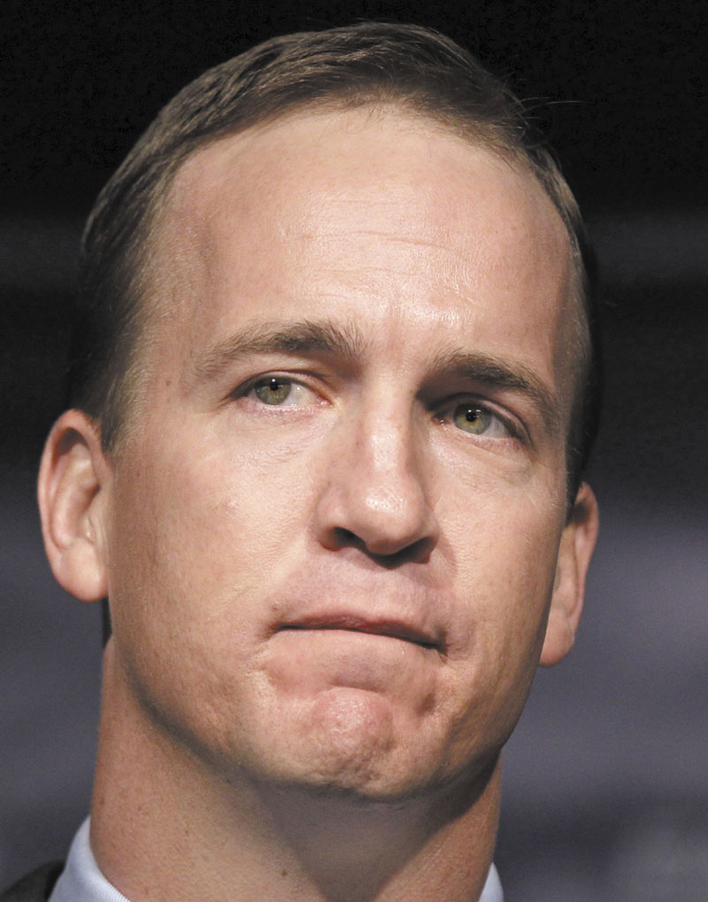 Quarterback Peyton Manning grimaces during a news conference in Indianapolis, Wednesday, March 3, 2012. Manning's record-breaking run as quarterback of the Colts ended Wednesday, when team owner Jim Irsay announced the team would release its best player. (AP Photo/Michael Conroy)