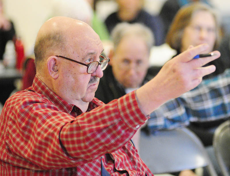 Resident Bob Bender asks a question during the annual town meeting on Saturday morning at the Pittston School.