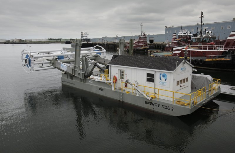 A prototype of Ocean Renewable Power Co.'s tidal power turbine was on display over the summer in Portland. It is seen here at the rear of the vessel Energy Tide 2. The prototype measured 46 feet, while the turbines being built for installation will be 90 feet long.