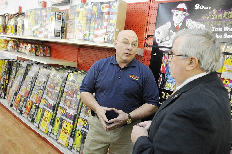 WELCOME TO PYRO CITY: On the opening day of his new store Pyro City, Steve Marson, left, chats on Thursday in Manchester with state Rep. Doug Damon, R-Bangor, who sponsored the bill last year that legalized fireworks sales in Maine.