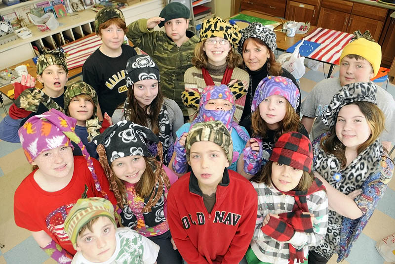 Fifth-graders pose for a photo wearing the hats they made in Betsy Allen-McPhedran's art class on Tuesday afternoon at Readfield Elementary School.