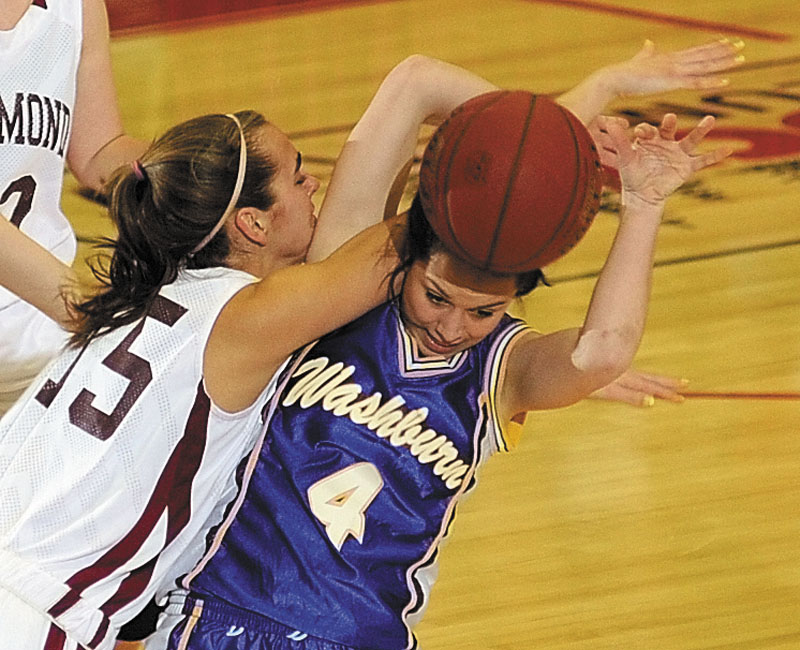 Richmond's Jamie Plummer, left, and Washburn's Rayah Saucier tangle up over a rebound during the Class D state championship game on Saturday afternoon at the Augusta Civic Center.