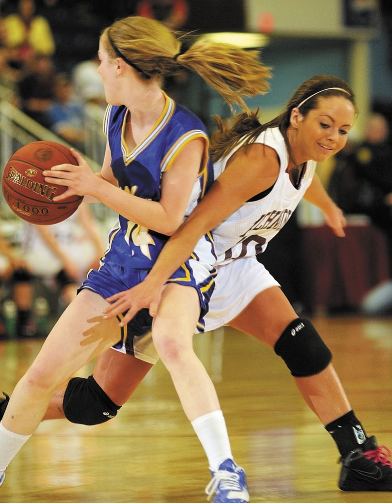 Washburn junior forward Mackenzie Worcester, left, steals the ball away from Richmond senior guard during the Class D state championship game on Saturday afternoon at the Augusta Civic Center.