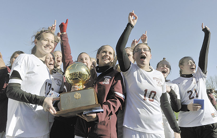No. 1 again: The Richmond girls soccer team holds up the Gold Ball after winning the Class D state championship in the fall. This year's junior class has won two state soccer titles.