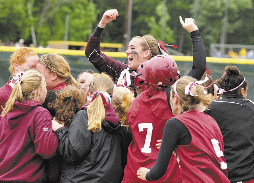 STATE BOUND: Richmond's Jamie Plummer leaps above her teammates as they celebrate their 3-2 victory over Buckfield in the Western Class D softball championship game last spring at St. Joseph's College in Standish. The Bobcats' junior class has one state title and will be looking for another this season.