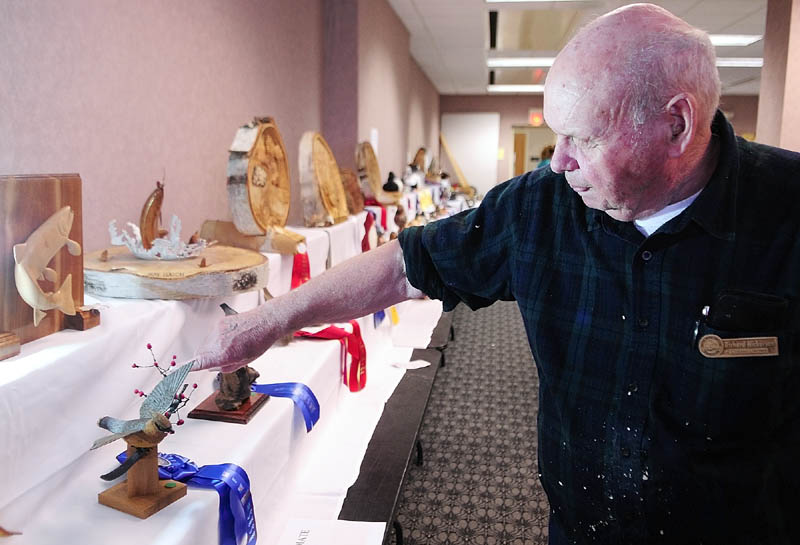Richard Nickerson talks about his prize-winning Cedar Waxwing carving Friday at the State of Maine Sportsman's Show at the Augusta Civic Center. The show runs through Sunday.