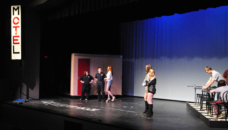 """Winthrop High School students rehearse """"The Queen of TE"""" on Tuesday at the school. Their entry in the State Drama Festival features a large lighted sign and two sets that swing on and off stage."""