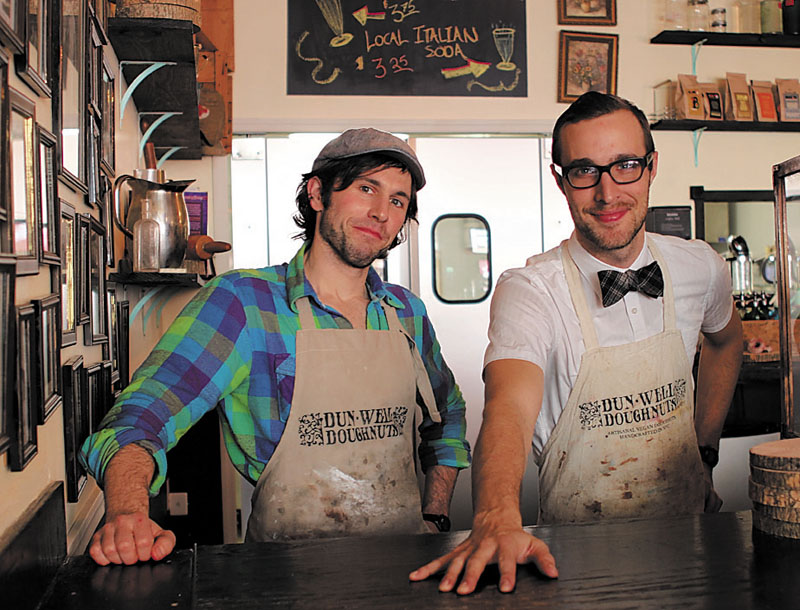 TIME TO MAKE THE DOUGHNUTS: Winslow High School graduate Dan Dunbar, left, and Christopher Hallowell are co-owners of Dun-Well Doughnuts in Brooklyn, N.Y. The shop was recently crowned by the New York Daily News as having the best doughnuts in the city.