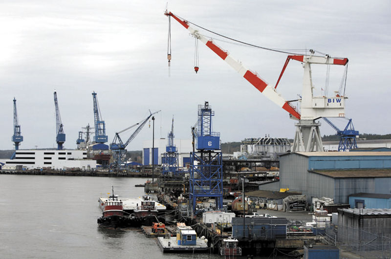 In this 2009 file photo, a large crane towers over the Bath Iron Works shipyard. Bath Iron Works had a storage building damaged in a fire on Tuesday, April 4, 2012. (AP File Photo)