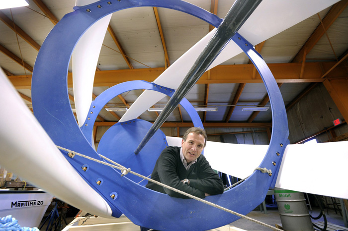 John Ferland, vice president of project development with Ocean Renewable Power Co., stands inside one of the company's all-composite tidal turbines in this February 2010 photo.