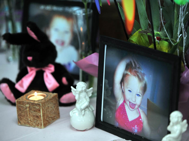 IN FAIRFIELD: A small shrine with pictures and teddy bears honoring missing toddler Ayla Reynolds at a gathering in honor of her at VFW Post 6924 on Saturday.