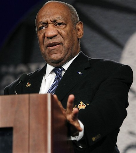 """In this April 6, 2011 photo, Bill Cosby speaks at the National Action NetworkÌs Keepers of the Dream Awards Gala in New York. Cosby says the debate over the killing of Trayvon Martin by a neighborhood watch volunteer should be focused on guns, not race. In an interview on CNN's """"State of the Union"""" aired Sunday, April 15, 2012, Cosby said calling George Zimmerman a racist doesn't solve anything. Cosby says the bigger question is what Zimmerman was doing with a gun, and who taught him how to behave with it. (AP Photo/Frank Franklin II)"""
