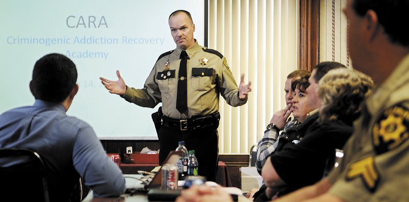 Kennebec County Sheriff Randy Liberty addresses corrections officers from across Maine Wednesday, explaining the rehabilitation program that the jail in Augusta administers. The Criminogenic Addiction Recovery Academy, known as CARA, helps inmates achieve sobriety and refrain from criminal conduct, Liberty said, and may serve as a model for jails across Maine.
