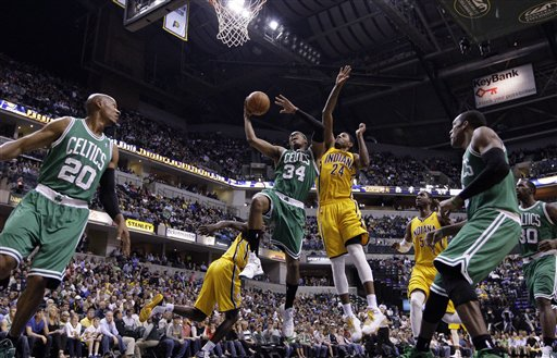 Indiana Pacers guard Paul George, blocks the shot from behind Boston Celtics forward Paul Pierce in the first half of an NBA basketball game in Indianapolis, Saturday, April 7, 2012. (AP Photo/Michael Conroy)