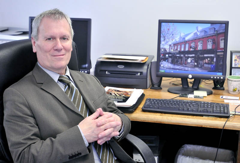 GROWTH GUY: Darryl Sterling, executive director for the Central Maine Growth Council, in his Waterville office.