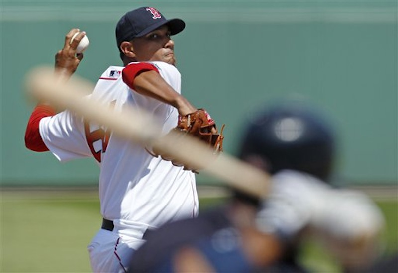 Boston Red Sox starter Felix Doubront winds up on a pitch to to Minnesota Twins' Alexi Casilla during the second inning of a spring training baseball game in Fort Myers, Fla., Monday, March 19, 2012. (AP Photo/Charles Krupa)