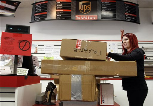 Employee Candy Mojica weighs packages before shipping at The UPS Store in Los Angeles recently.