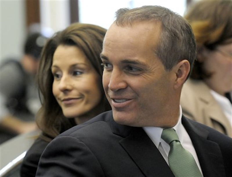 In this March 12, 2010 file photo, Andrew Young, former aide to former Sen. John Edwards, and his wife, Cheri, appear during a hearing at the Chatham County Superior Court House in Pittsboro, N.C. Prosecutors accuse Edwards of using campaign money from wealthy donors to hide his pregnant mistress, Rielle Hunter. Young testified for five days in the week ending Friday, April 27, 2012. He said Edwards knew the money was being spent to hide Hunter, but also acknowledged that he used much of the funds to build his North Carolina dream house. (AP Photo/Sara D. Davis, File)