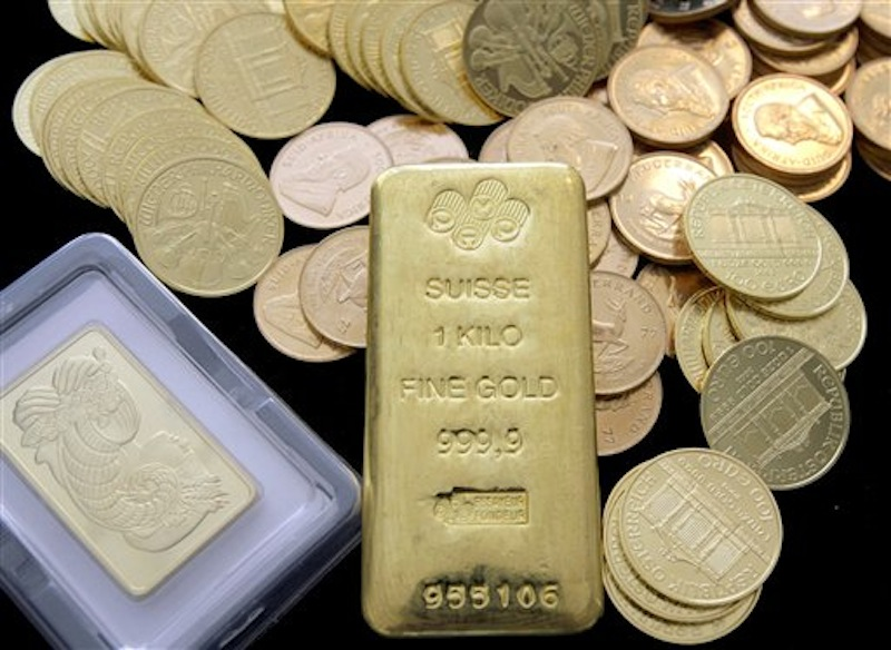 In this March 13, 2008 photo, gold coins and bars are shown at California Numismatic Investments in Inglewood, Calif. The price of gold, which has climbed for years like a blood pressure reading for anxious investors, plunged Wednesday, April 4, 2012 to its lowest level in three months. Gold fell almost $58 to $1,614 per ounce. It has declined 15 percent since September, when it hit a peak of $1,907. It had more than doubled from the financial crisis three years earlier. (AP Photo/Nick Ut)