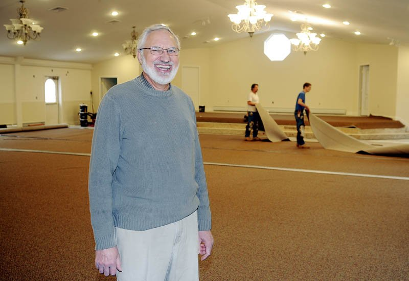 Workers install carpets Thursday in the newly renovated chapel at the Faith Christian Church in Gardiner where Pastor Glenn Metzler officiates.