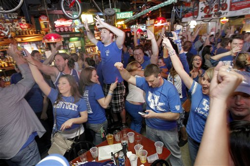 University of Kentucky fans celebrate after the final horn on Monday at Lynagh's Irish Pub & Grill in Lexington, Ky.