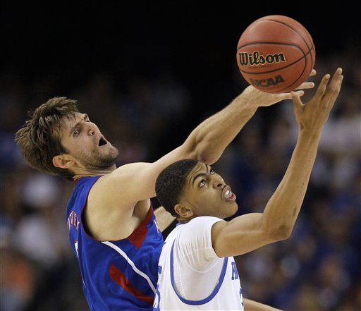 Kansas' Jeff Withey fights for a loose ball with Kentucky's Anthony Davis, right, during the first half of the NCAA Final Four tournament college basketball championship game tonight in New Orleans.