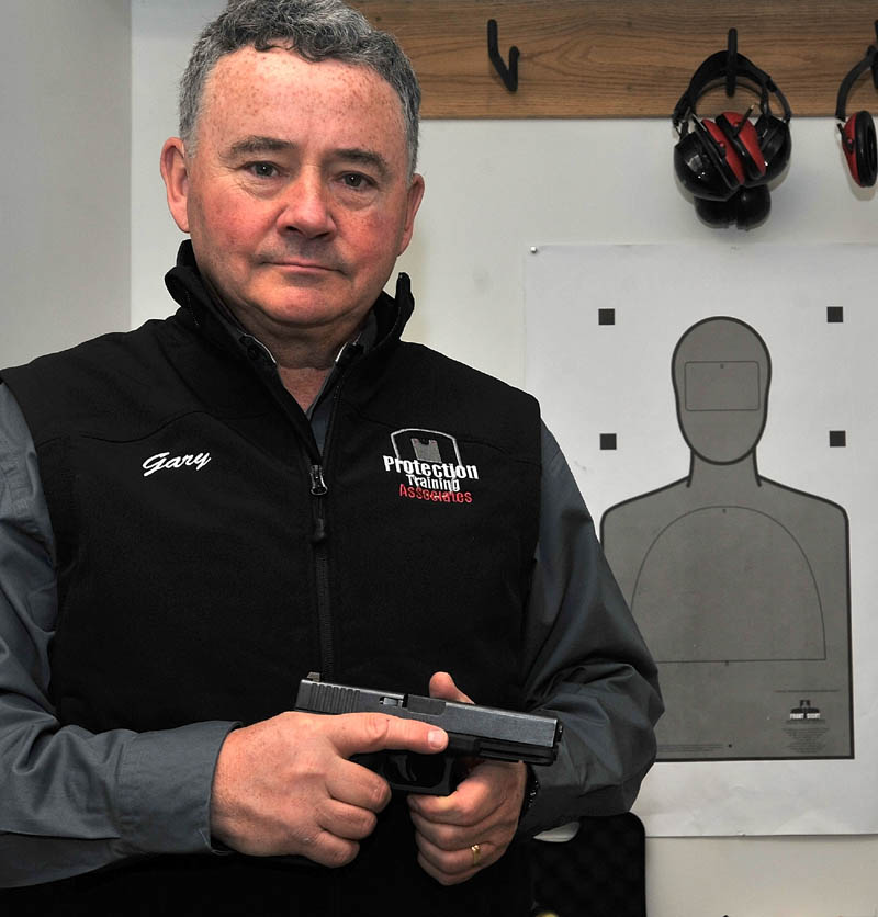 Gary Hilliard, owner of Protection Training Associates at 511 Dunn Road in Belgrade, poses for a portrait in his classroom used for instructing new gun owners on how to handle their firearm safely.