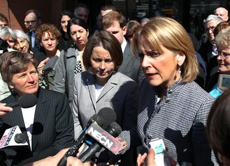 Attorney General Martha Coakley, right, addresses reporters outside, along with Mary Bonauto, an attorney for GLAD, and Maura Healey, center, the Chief of Public Protection and Advocacy Bureau with the AG's office at the U.S.Court of Appeals at the Moakley Federal Court on Wednesday April 4, 2012 in Boston. Lawyers for a gay and lesbian legal advocacy group have a told a federal appeals court panel that a federal law that denies benefits to married gay couples that heterosexual couples get is discriminatory. (AP Photo/The Boston Globe,John Tlumacki)