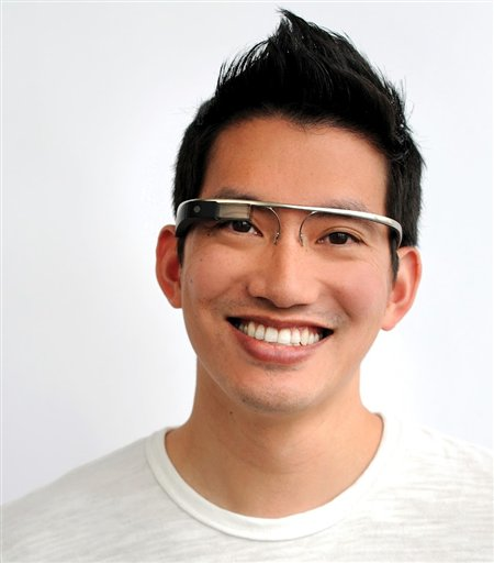 """In this undated handout photo provided by the Google[x] group's """"Project Glass"""", an early prototype of Google's futuristic Internet-connected glasses, are modeled. The specs are said to give you directions, let you video chat, shop and do everything else you now need a handheld gadget to accomplish. Google gave a glimpse of �Project Glass� in a video and blog post this week. (AP Photo/Google)"""