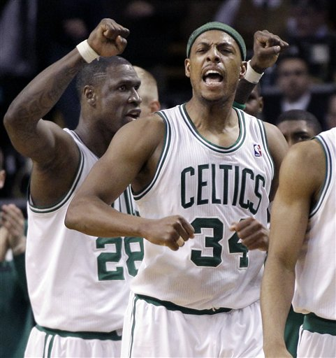 Boston Celtics forwards Paul Pierce (34) and Mickael Pietrus (28) celebrate in the last seconds of overtime against the Atlanta Hawks in an NBA basketball game in Boston Wednesday, April 11, 2012. The Celtics won 88-86. (AP Photo/Elise Amendola)