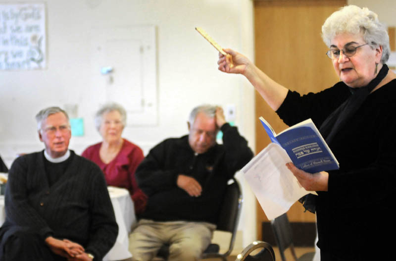 Rabbi Susan Bulba Carvutto blesses matzo Thursday while explaining the Jewish holiday of Passover at Saint Mark's Episcopal Church in Augusta. Members of the Jewish and Christian faiths celebrated Maundy Thursday and Passover on Saturday together.