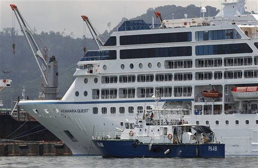 A police boat is moored next to the cruise ship Azamara Quest in Sandakan, Malaysia, today.