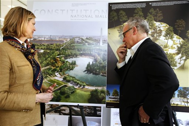 In this photo taken Thursday, April 5, 2012, Caroline Cunningham, President of the Trust for the National Mall, left, and Donald Stastny, an architect advising the trust, look at two of several proposed designs for overused and neglected areas of the National Mall in Washington. (AP Photo/Jacquelyn Martin)