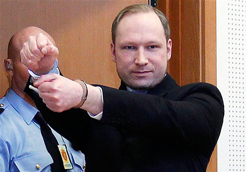 In this Feb. 6, 2012 file photo, Anders Behring Breivik, a right-wing extremist who confessed to a bombing and mass shooting that killed 77 people on July 22, 2011, gestures as he arrives for a detention hearing at a court in Oslo, Norway. Breivik is not criminally insane, a psychiatric assessment found Tuesday, April 10, 2012 contradicting an earlier assessment. The new conclusion comes just six days before Breivik is scheduled to go on trial on terror charges for the massacre on July 22. (AP Photo/Heiko Junge, Scanpix Norway) BNC