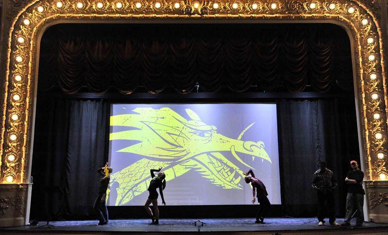 """Dancers with the Kennebec Dance Center rehearse a scene from the musical """"Chicago"""" before the grand re-opening of the Waterville Opera House Friday night. This show is the first after being closed a year for a $4.9 million renovation and addition project."""