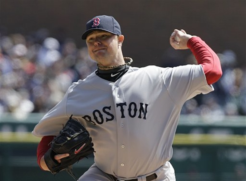 Boston Red Sox starting pitcher Jon Lester (31) throws during the second inning of a baseball game against the Detroit Tigers in Detroit, Thursday, April 5, 2012. Lester went seven innings and only allowed one run, but the Sox lost 3-2. (AP Photo/Carlos Osorio)