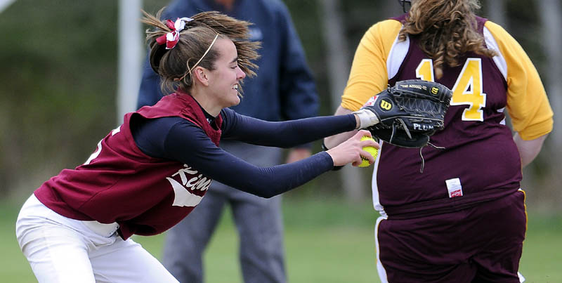 Staff photo by Andy Molloy BALL IN THE HAND: Richmond High School's Jamie Plummer can't connect with an out at first after a late throw to allow Buckfield High School's Hannah Gallant to take the base during a softball match up at Richmond.