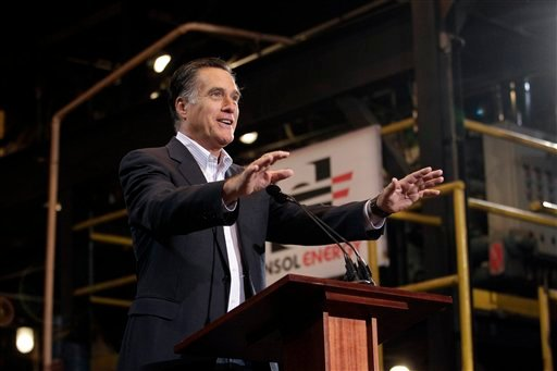 Republican presidential candidate Mitt Romney gestures appears at a campaign rally in South Park Township, Pa., on Monday.