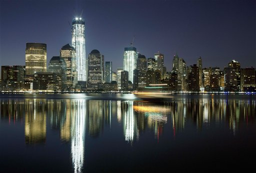 One World Trade Center towers above the Lower Manhattan skyline and Hudson River in New York.