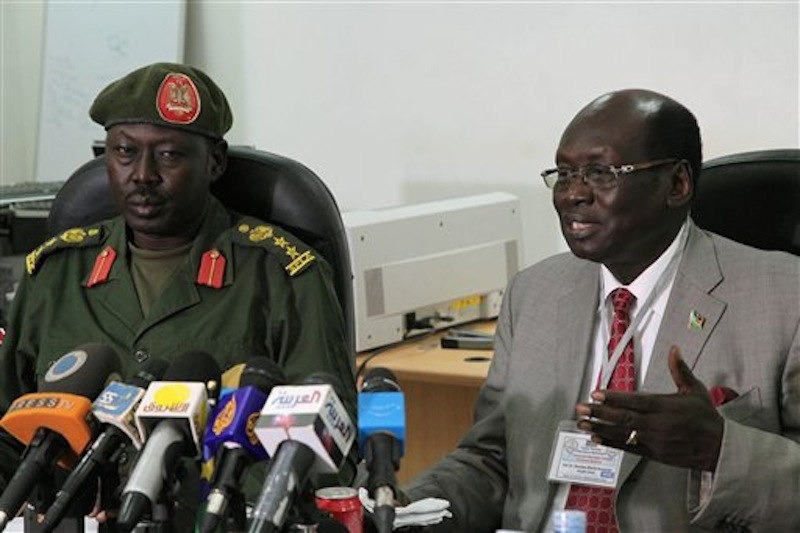 South Sudanese Minister of Information Barnaba Benjamin Marial, right, and Military Spokesman Philip Aguer brief the media on Tuesday, March 27, 2012 in Juba, South Sudan about recent fighting between Sudanese and South Sudanese forces along the north-south border. South Sudan said Wednesday, April 4 it had shot down a Sudanese jet after its oil fields were bombed. (AP Photo/Michael Onyiego)