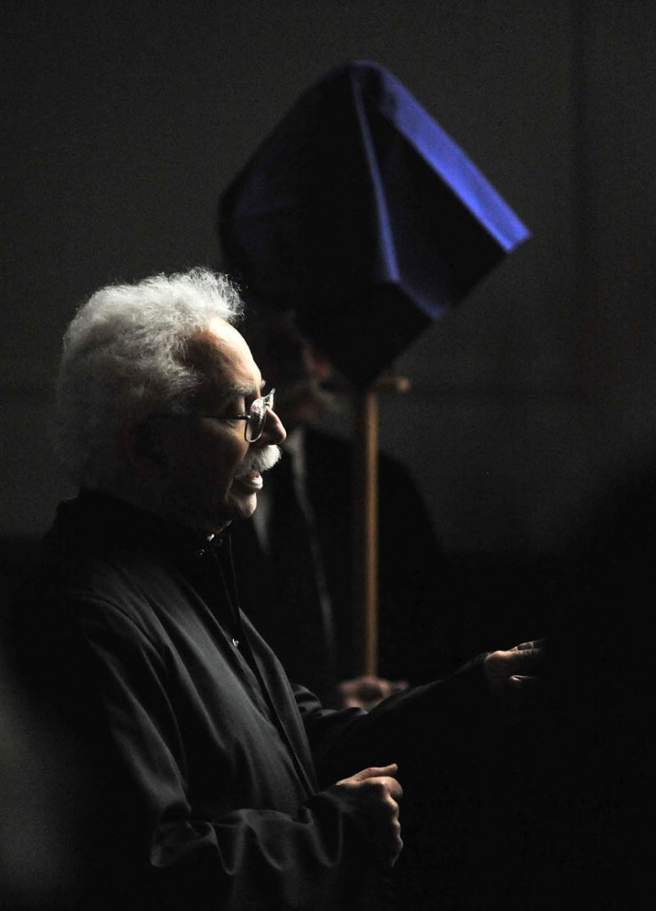 Staff Photo by Michael G. Seamans Deacon Edwin Kalish leads Good Friday Mass at Sacred Heart Church in Waterville. The Holy Trinity Anglican Church rents space at Sacred Heart Church.