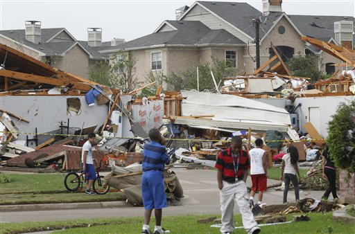 Neighbors view what remains of a home in Arlington, Texas, Tuesday.